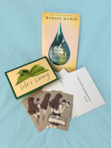 book, letter, postcards, and book plates